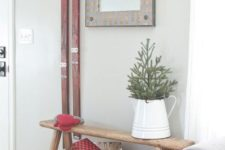 11 a vintage rustic entryway styled with a wooden box with firewood and red vintage skis is a very cozy space