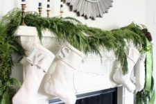 11 decorate your mantel with a fresh evergreen garland and some lights and stockings to make it fresh and festive