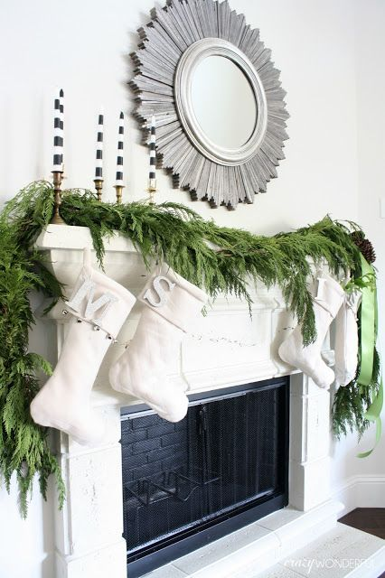 decorate your mantel with a fresh evergreen garland and some lights and stockings to make it fresh and festive