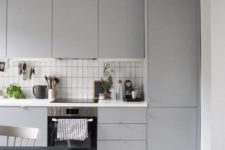12 a Scandinavian grey kitchen done with sleek dove grey cabinets and a white backsplash with black grout