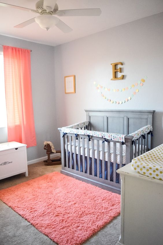 a fluffy coral rug and matching curtains are amazing to refresh any neutral nursery to give it a cool look