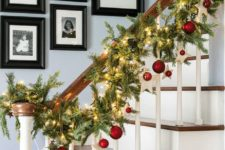 12 decorate your railway with an evergreen garland with lights and red ornaments reminding of your Christmas tree