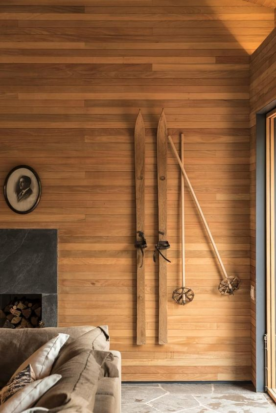 even a contemporry or minimalist home can be accented with some skis for a wintry feel at once