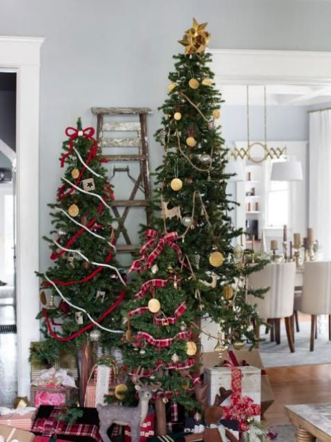 a trio of Christmas trees decorated with vintage ornaments and some plaid and gold ribbons for holidays