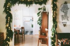 13 line up your archway with an evergreen Christmas garland with lights, which is a simple and cool idea