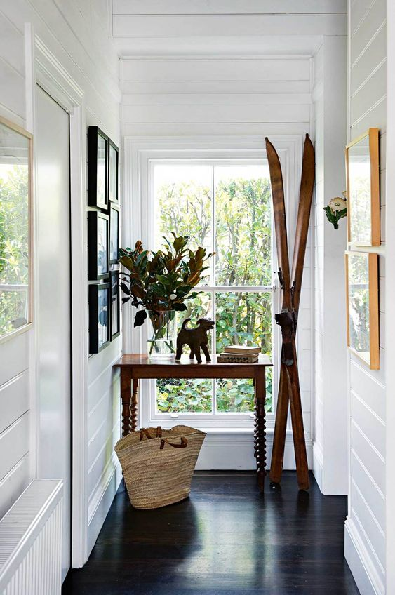 place skis next to your console table for an instant winter feel, this is a simple decor idea