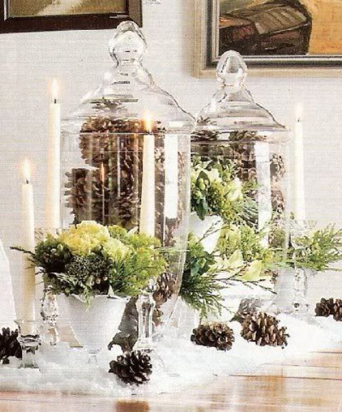 tall glass jars filled with pinecones and with greenery arrangements are a great idea for a centerpiece