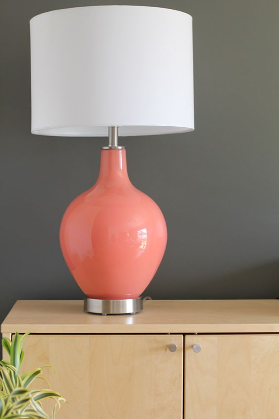 an ultra-modern lamp with a simple white shade and a sleek coral base is right what you need