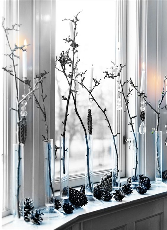 simple window decor with pinecones, branches in vases and crystals hanging on them
