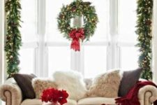 14 style your window with a lush evergreen garland with red bows, pinecones and lights to make the living room inviting