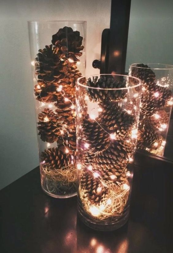 tall glass vases filled with pinecones and LEDs will bring a rustic yet modern touch to your space