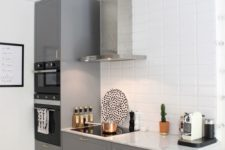 16 a stylish contemporary space with grey cabinets, a white tile backsplash and a stainless steel hood looks airy