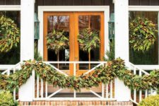 16 evergreen garlands with pinecones and foliage can be used for styling railing and matching wreaths on the windows