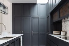 20 a graphite grey kitchen with sculptural panelling and a marble backsplash and countertops