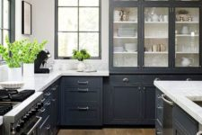 21 a graphite grey traditional kitchen with stainless teel accents and appliances and vintage lamps
