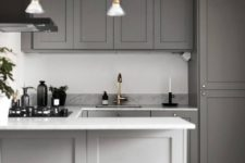 23 a simple contemporary space done in grey, with a white backsplash, stone countertops and metallic touches