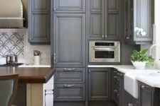 26 dark grey wash cabinets with silver knobs look very sophisticated and vintage, it's spruced up with whites