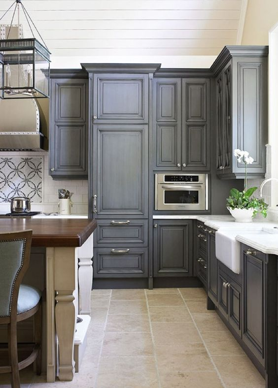 dark grey wash cabinets with silver knobs look very sophisticated and vintage, it's spruced up with whites