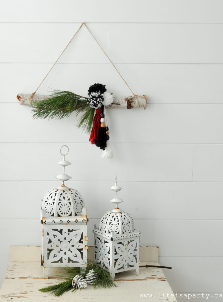 DIY modern boho Christmas wreath with pompoms and tassels with evergreens (via www.lifeisaparty.ca)