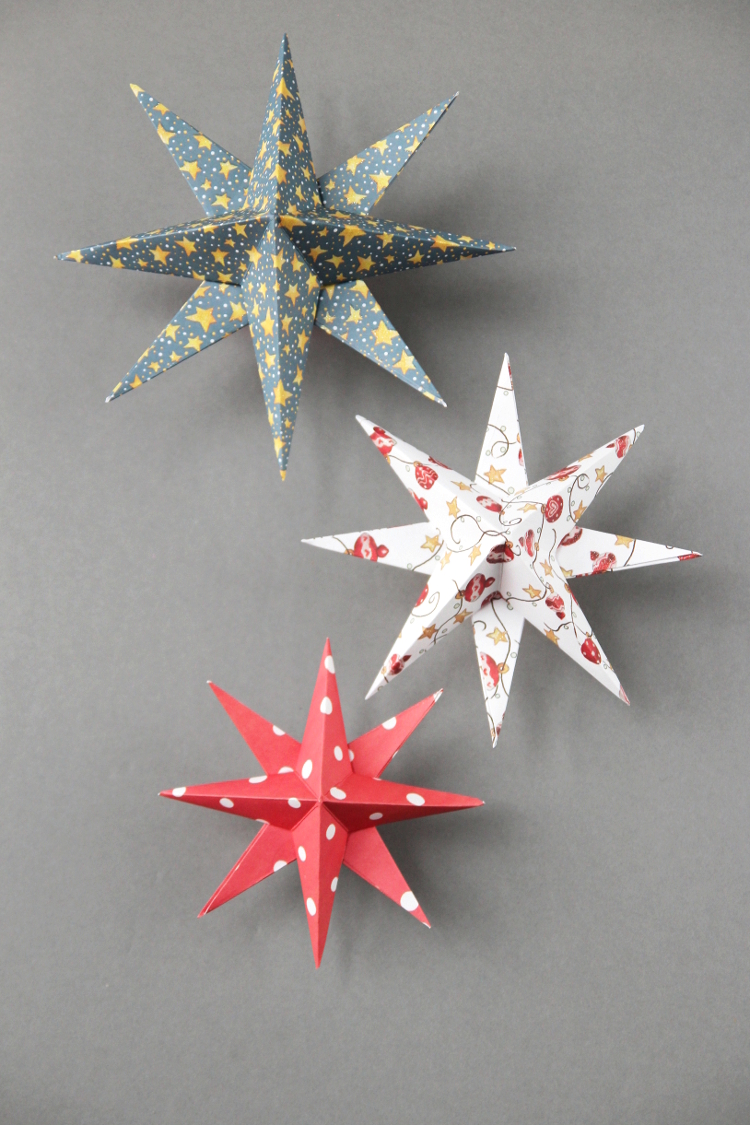 DIY colorful 3D paper star Christmas ornaments  (via www.gatheringbeauty.com)