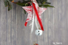 DIY wooden Christmas star ornament with jingle bells