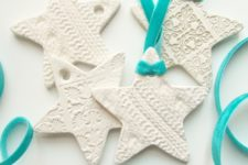 DIY embossed clay star Christmas ornaments in white