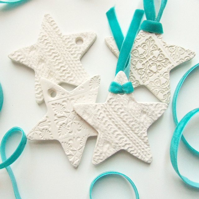 DIY embossed clay star Christmas ornaments in white (via www.gatheringbeauty.com)