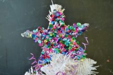 DIY colorful sequin star Christmas ornament with hot glue