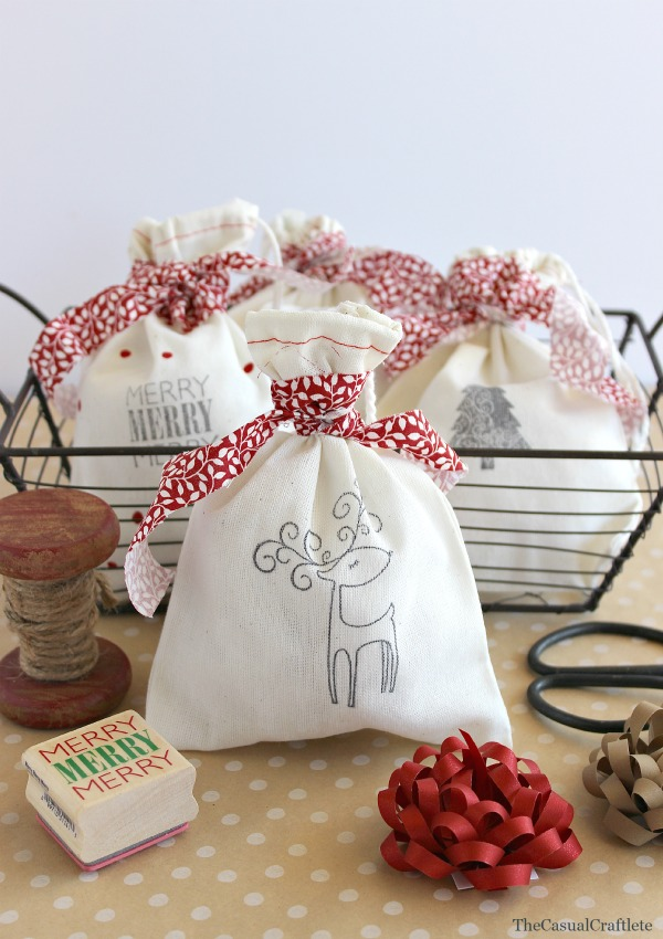 DIY stamped Christmas bags with reindeer and red ribbon (via www.purelykatie.com)