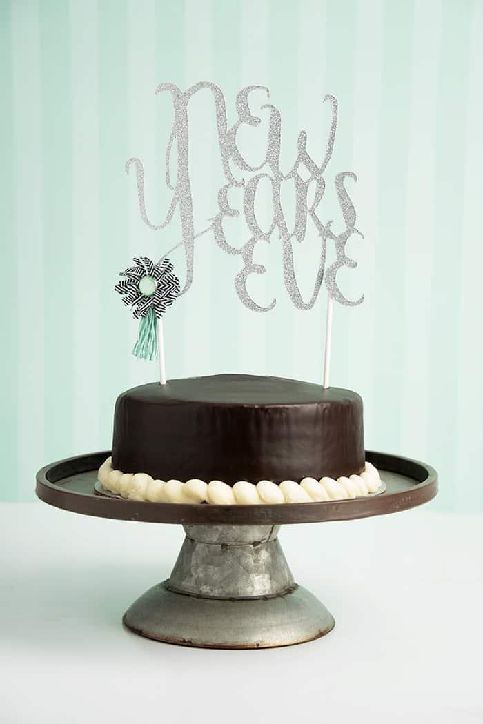 DIY silver glitter cursive letter cake topper (via diycandy.com)