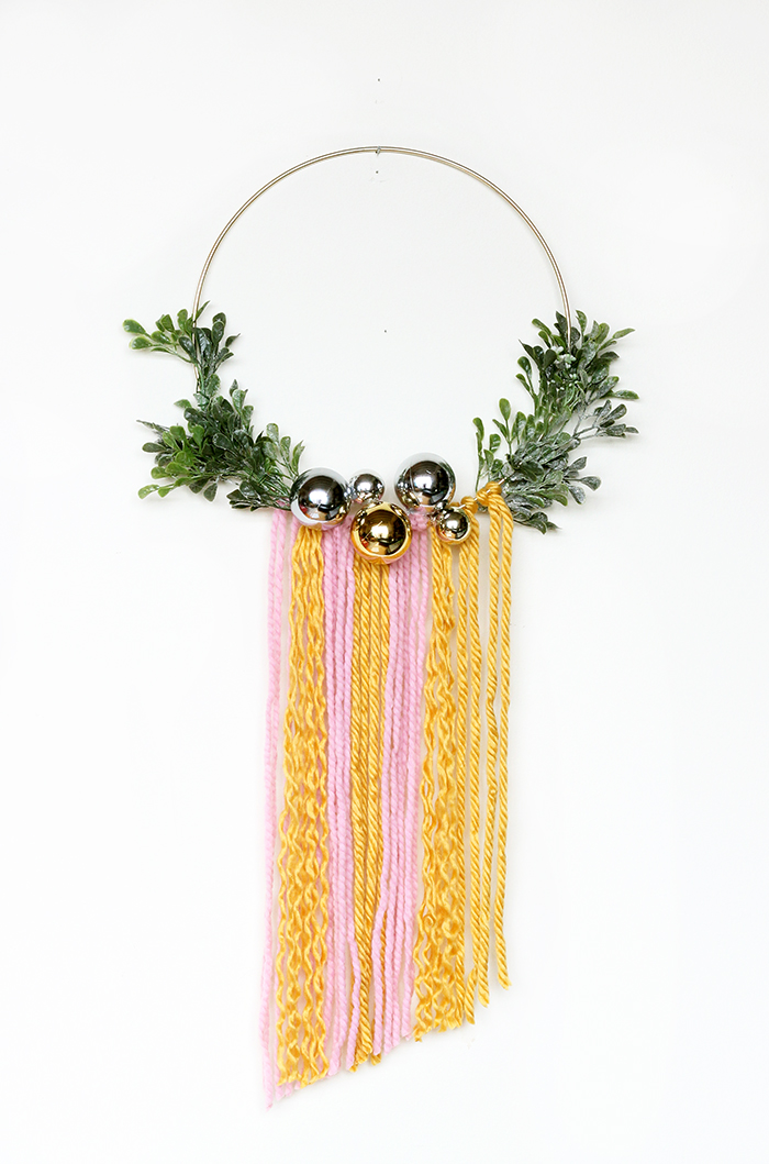 DIY modern Christmas wreath with long colorful fringe and ornaments (via thesweetescape.ca)
