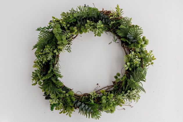 DIY faux evergreen Christmas wreath with a vine base (via www.hunker.com)