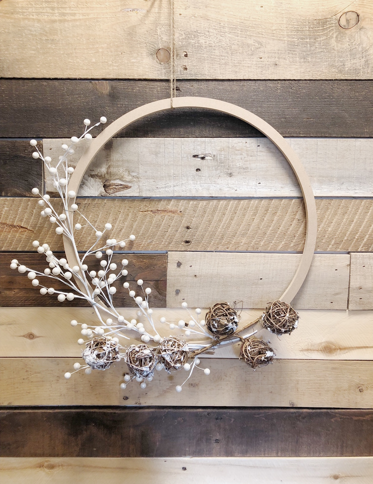 DIY modern Christmas wreath with fake berries and vine balls