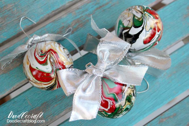 DIY marble Christmas ornaments in traditional holiday colors (via www.doodlecraftblog.com)