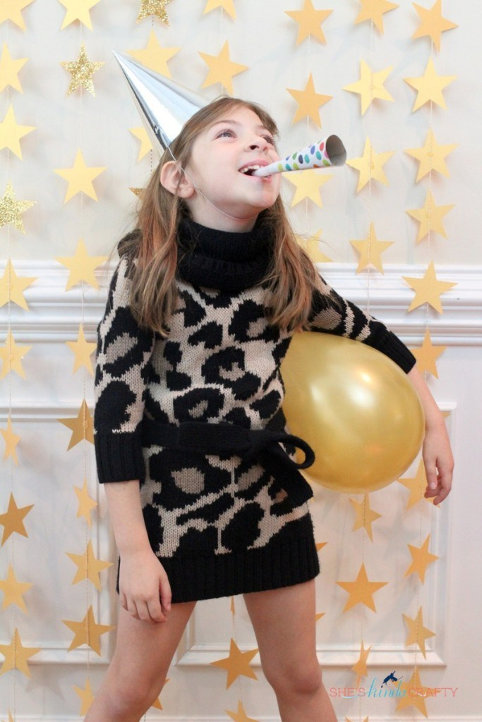 DIY star curtain New Year's party backdrop (via tatertotsandjello.com)