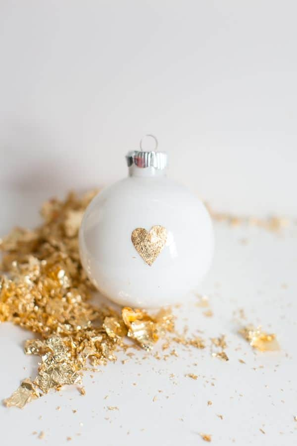 DIY white Christmas ornaments with gold leaf hearts (via helloglow.co)