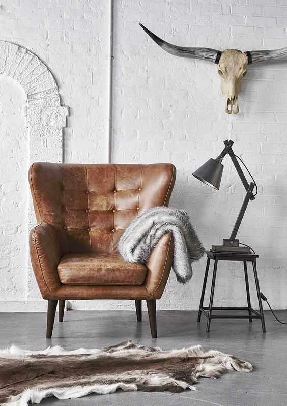 a brown wingback leather chair with a cushion is a stylish piece to rock for more comfort