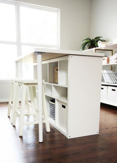 a comfy kitchen island of IKEA Kallax featuring a storage and a breakfast space