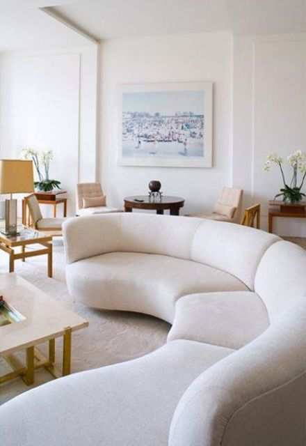 a creamy curved sofa like this one is a bold statement for a modern stylish living room