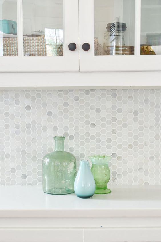 marble hex penny tiles with white grout look timeless and add a right amount of interest to a neutral kitchen