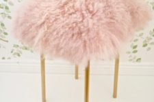 03 DIY IKEA Marius stool into a fluffy pink one with brass legs adds glam to the space