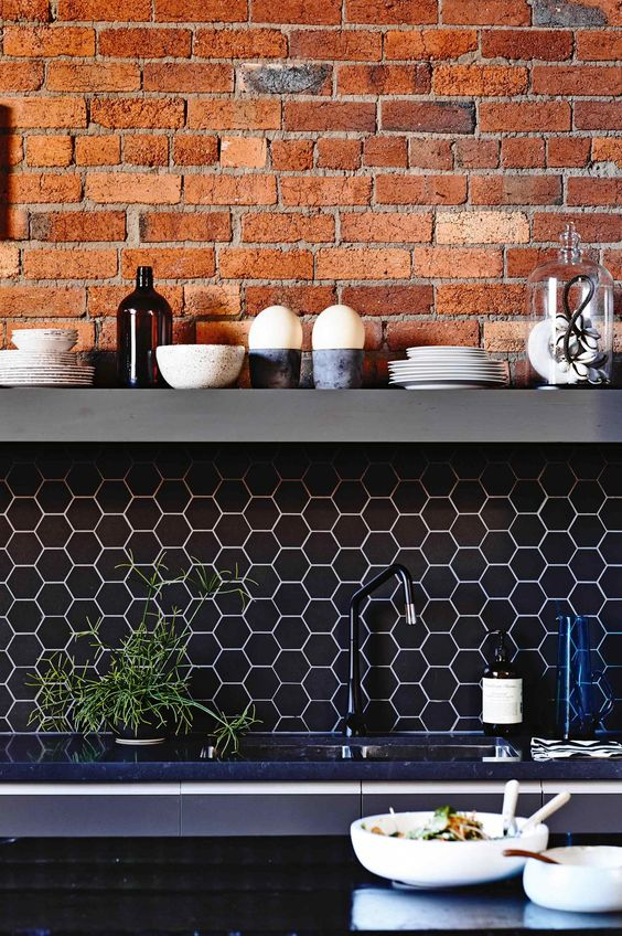 a brick wall with a navy hex tile backsplash and white grout is a bold idea for a contemporary kitchen