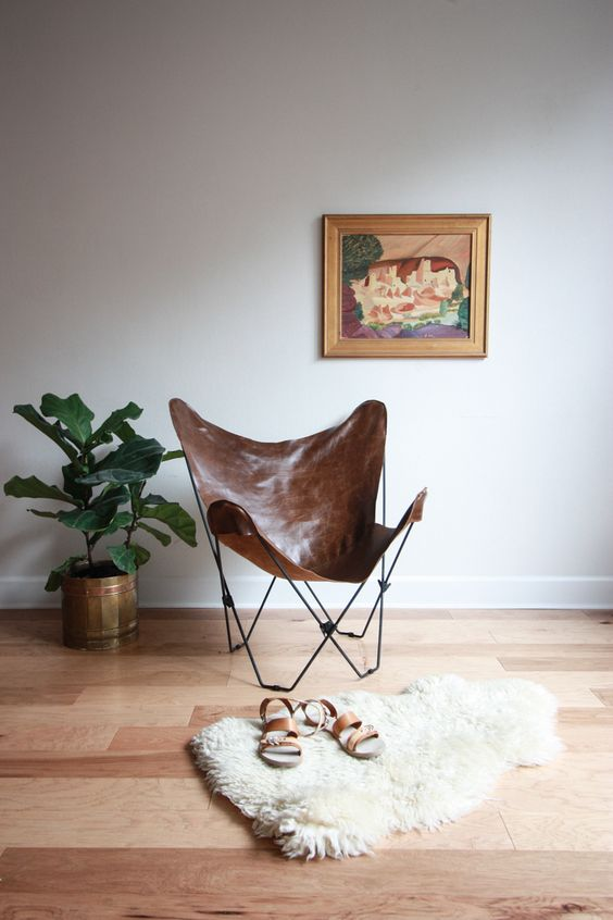 a leather butterfly chair is mid-century modern classics that always works