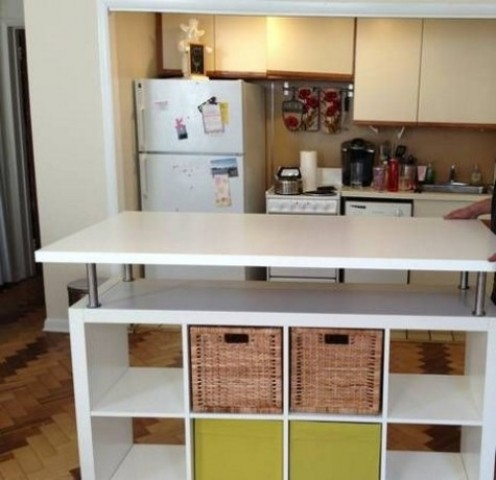 an Expedit bookcase turned into a kitchen with an additional bar countertop and drawers