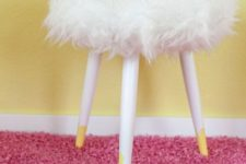 06 a simple three-legged stool renovated using bright yellow paint and Tejn fur from IKEA