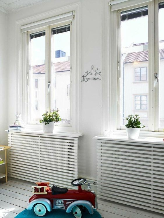 get some simple plank screens in IKEA and attach them to cover your radiators easily