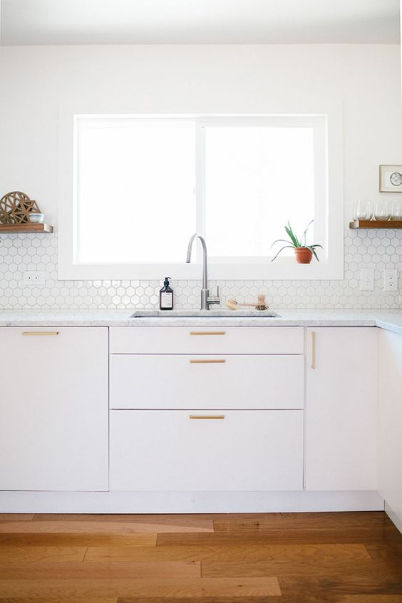 small scale hex tiles on the backsplash bring a pattern and a texture to the all-neutral kitchen