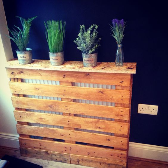 grab a pallet, give it stain and make a simple and modern screen to cover your radiator
