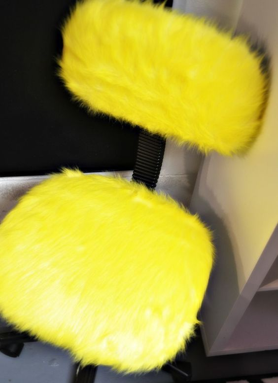 SKRUVSTA Swivel chair covered in yellow painted fur from IKEA