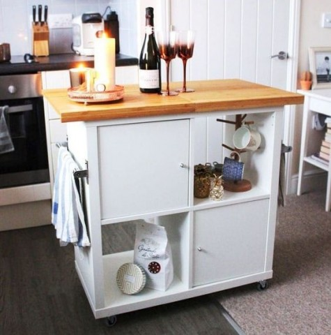 a mobile kitchen island with open and closed storage compartments made from IKEA Kallax